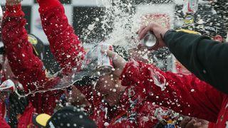 A shower of celebration surrounded Dale Earnhardt Jr. in 2004.